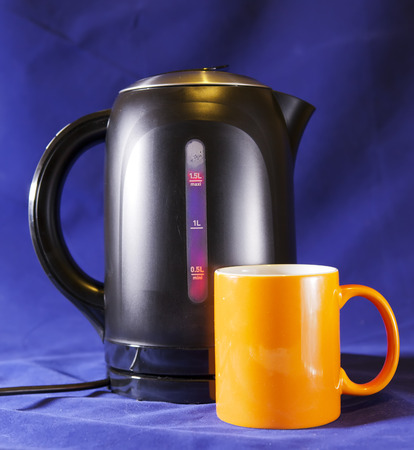 electric tea kettle: electric tea kettle and a mug Stock Photo