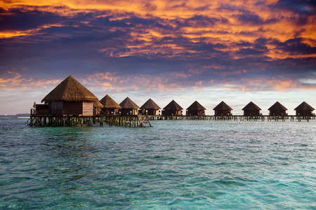 lodges: Lodges over water at the time sunset. Maldives.