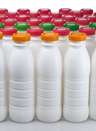 mass storage: dairy products bottles with bright covers Stock Photo