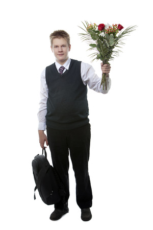 final examination: The pupil of the senior classes in a school uniform with a bouquet of flowers Stock Photo