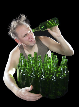 tipsy: The tipsy man wants to drink the last drink of beer from an empty bottle