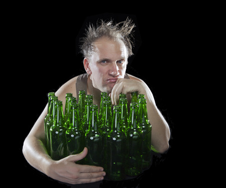 tipsy: The tipsy man sits with a heap of beer bottles, a hangover