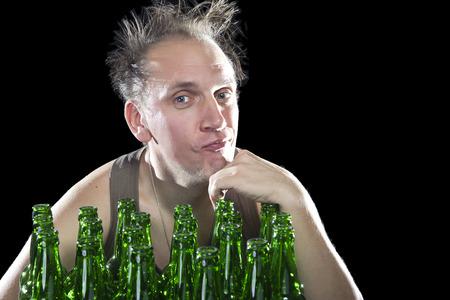 near beer: The happy tipsy man near empty beer bottles Stock Photo