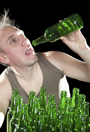 sobriety: The tipsy man wants to drink the last drink of beer from an empty bottle