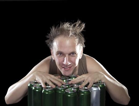 sobriety: The happy tipsy man near empty beer jars
