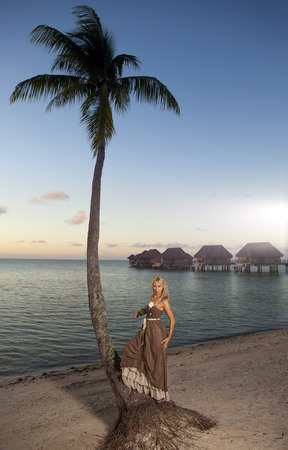 borabora: The beautiful woman with a rose at a palm tree.  Tahiti