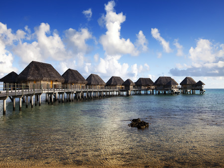 small houses: Typical Polynesian landscape -small houses on water.