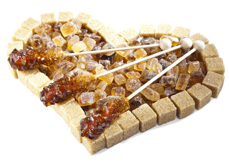 refined: Heart from not refined reed sugar and candy sugar on a stick Stock Photo