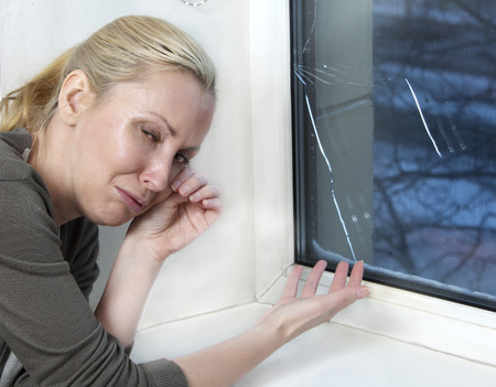 cries: The housewife cries, bad quality window has burst because of cold weather