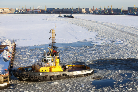 seaport: Operation of the auxiliary ships in seaport of St. Petersburg during winter navigation. Russia.