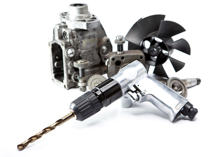 impact wrench: Car repair - details of the pump of high pressure and air drill on white background Stock Photo