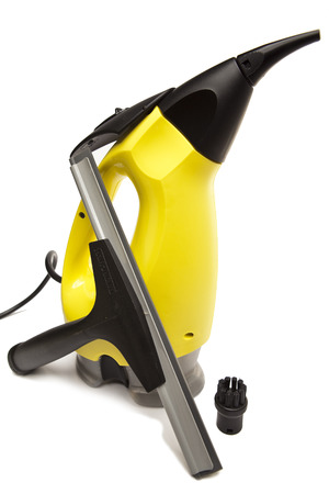 removed: handheld steam cleaner and brush nozzle