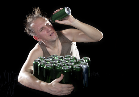 sobriety: Hangover. The man examines, whether there is no beer drop in a can