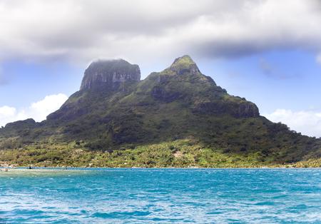 otemanu: The blue sea and clouds over the mount Otemanu on Bora Bora island, Polynesia.