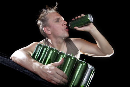 binge: Hangover. The man examines, whether there is no beer drop in a can
