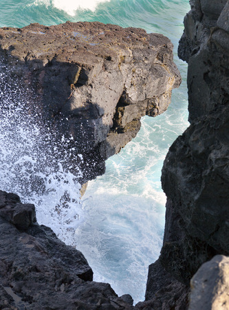 neighboring: Gris Gris cape on South of Mauritius. The wave breaks against neighboring rocks