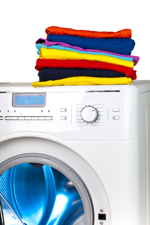 Pile of colorful clothes on the washing machine Stock Photo