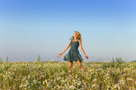 camomiles: The happy young woman  in the field  of camomiles