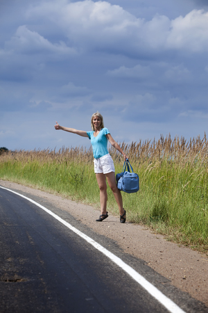 hitchhiking: Hitchhiking girl votes on road