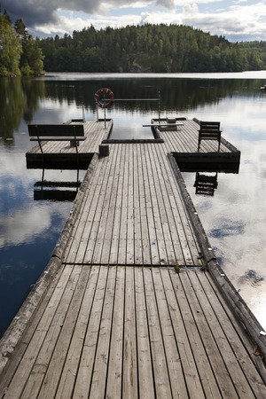 The mooring on the forest lake. Finland Stock Photo
