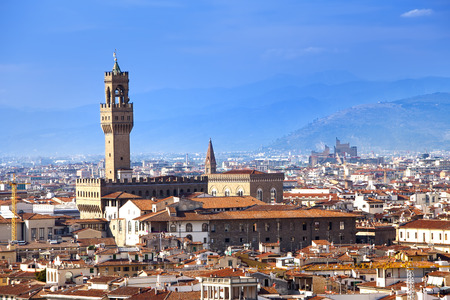 signoria square: The clock tower of the Old Palace (Palazzo Vecchio) in Signoria Square, Florence (Italy).
