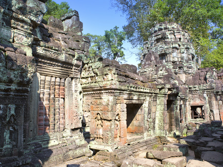 translated: Preah Khan(it is translated as A sacred sword). Trees and ruins of the temple, Siem Reap, Cambodia Stock Photo
