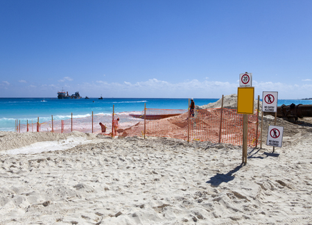 berm: laying new sand on the beach. Mexico. Stock Photo
