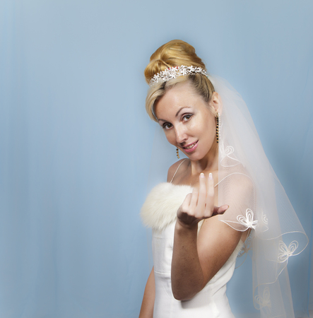 attracts: The bride invitingly attracts the viewer a hand Stock Photo