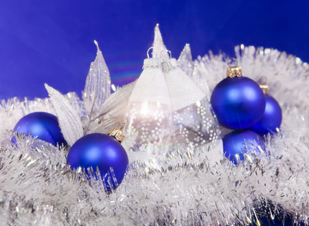 Blue New Years balls and tinsel on a blue background