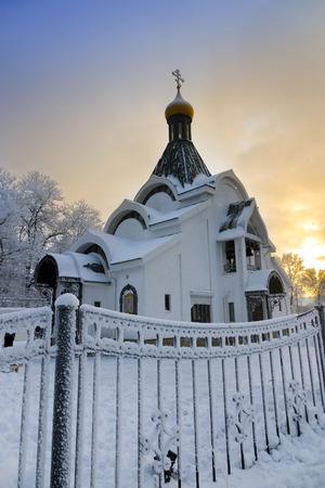 Small orthodox church during snowfall. Stock Photo