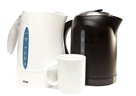 electric tea kettle: two electric tea kettle on a white background and a mug.