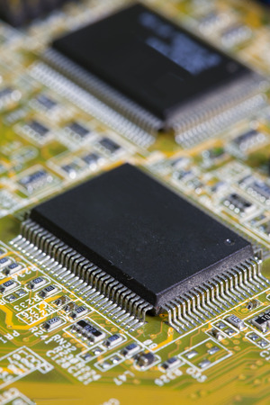 Electronic chip and standard inscriptions of resistors and condensers, small depth of sharpness