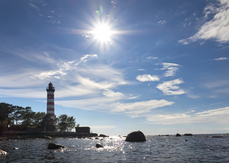 Sunshine over a Lighthouse. St. Petersburg. Gulf of Finland Stock Photo