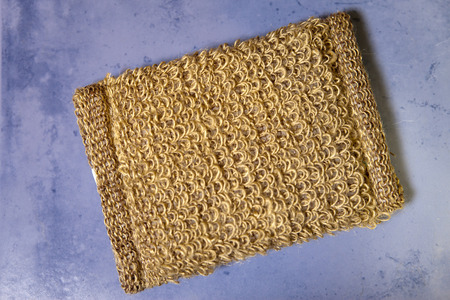 bast from natural fiber on a tile, flat lay