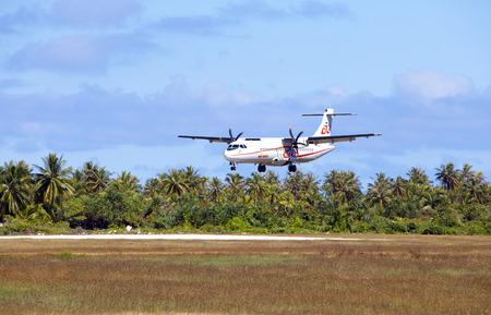 POLINESIA- JUNE 16:  screw plane - ATR 72 Air Tahiti companies makes landing on the small tropical island Tikehau on june 16, 2011 in French Polynesia