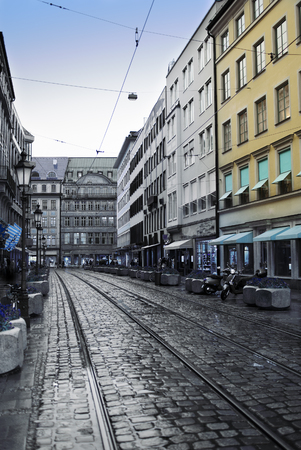 old center: Munich. The street in the center of the old city with a stone blocks and tram ways