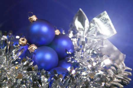 Blue New Year balls and tinsel on a blue background Stock Photo