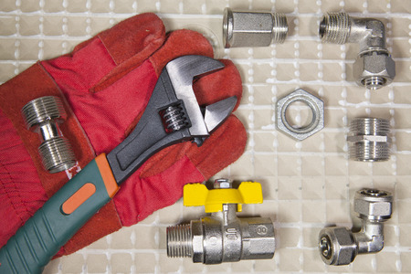 adjust wrench power grip and elements of water and gas shutoff valves, flat lay