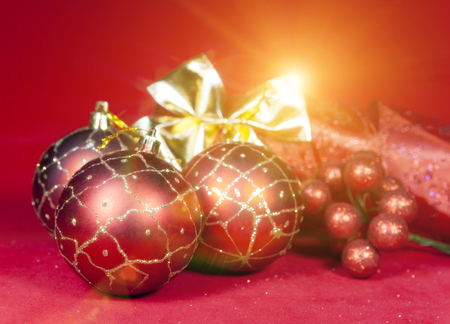 Red New Years ball, decorative berries and tinsel Stock Photo