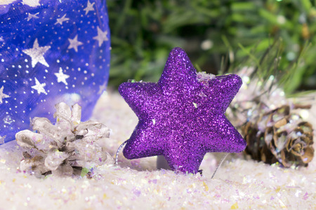 Decorative violet New Years snowflake and New Years ball