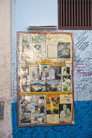 HAVANA, CUBA - JANUARY 27, 2013: Restaurant Bodeguita del Medio. Poster with autographs about an entrance.  This restaurant was favourite of Ernest Hemingway and other celebrities