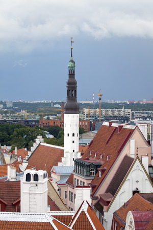 aerial view on observation deck of Old citys roofs and St. Nicholas Church (Niguliste) . Tallinn. Estonia