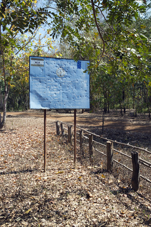 SIEM REAP, CAMBODIA - FEBRUARY 02, 2015: the information sign CMAC-Cambodian Mine Action Centre - about mine clearing of the territory of the temple of Leung, Koh Ker temple complex Sajtókép