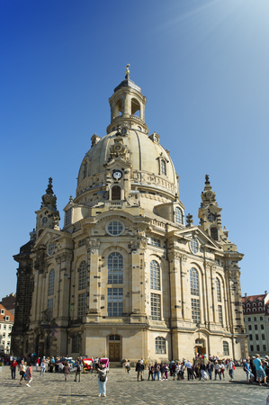 DRESDEN, GERMANY - SEPTEMBER 17: People walk on Neumarkt Square at Frauenkirche (Our Lady church) in the center of Old town