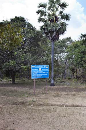 SIEM REAP, CAMBODIA - FEBRUARY 02, 2015: the information sign CMAC-Cambodian Mine Action Centre - about mine clearing of the territory of the temple of Boeng Mealea, Koh Ker temple complex