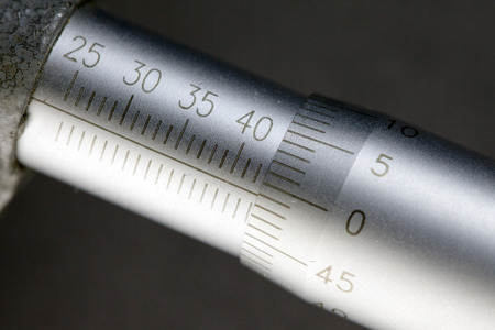 Micrometer, measuring scale close-up Stock Photo