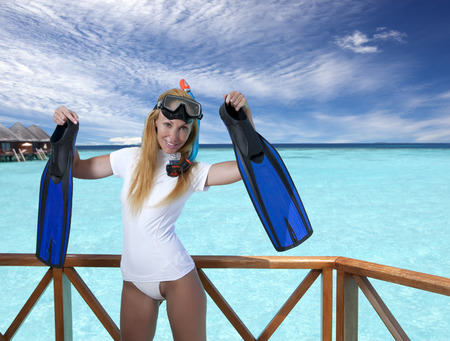 Young pretty woman with flippers, mask and tube. 