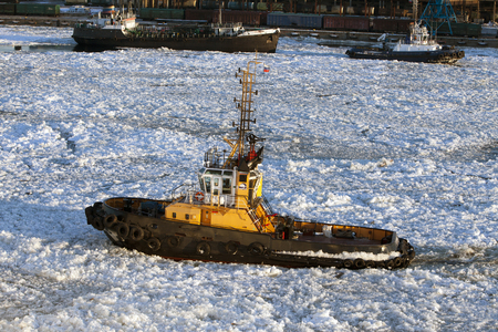 auxiliary ships in seaport of St. Petersburg during winter navigation. Russia 版權商用圖片