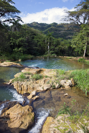 The river with stages in park of Soroa. Cuba. Imagens