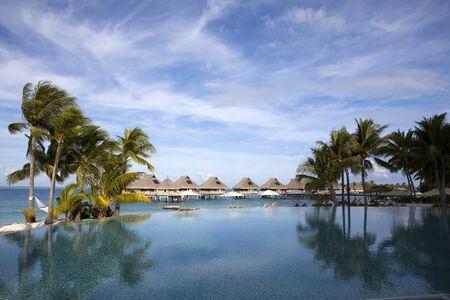 The pool under palm trees on the seashore.Polynesia, Tahiti